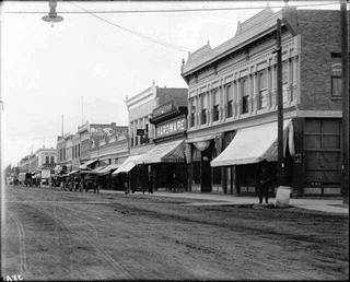 The above public domain photos depict Main Street Montrose in 1910, left, and the Gunnison Tunnel in 1909, Wikipedia photos.