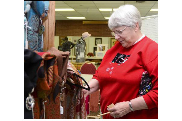 Montrose resident Madeline Glatfelder took time to check out the scarves at the Ouray Arts and Crafts Fair Feb. 15. Photo by Cara Fandel Photography.