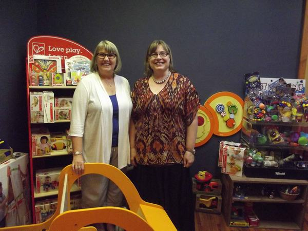 Above, Gail Kubik and Sonja Horn in the toy section of Horn's newly expanded and very enticing boutique, Fabula at 317 East Main Street, Montrose, CO.