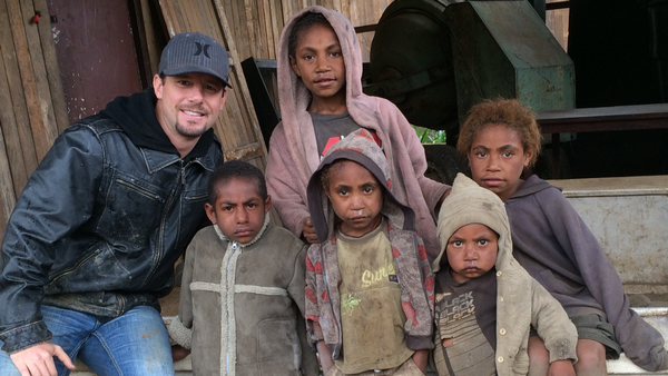 Gary Bustin of Montrose, above with street children in Papua New Guinea, created PNG Tribal Foundation to accelerate support for humanitarian causes in the is-land nation where he was born and spent his childhood.